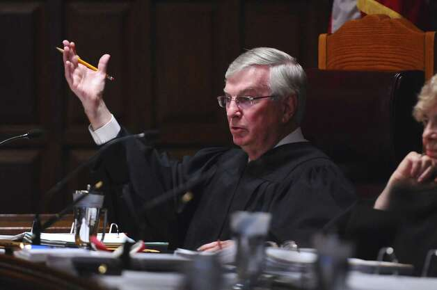 New York State Court of Appeals associate justice Eugene F. Pigott, Jr. makes a point during arguments in a case disputing whether Nite Moves should have to pay certain state sales taxes, on  on Wednesday afternoon Sept. 5, 2012 in Albany, NY.   (Philip Kamrass / Times Union) Photo: Philip Kamrass / 00019131A