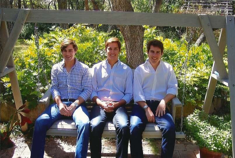 In 2012, the Swain boys, Brandon 23, Dillon 18, and Colby 26, relax on a swing together.