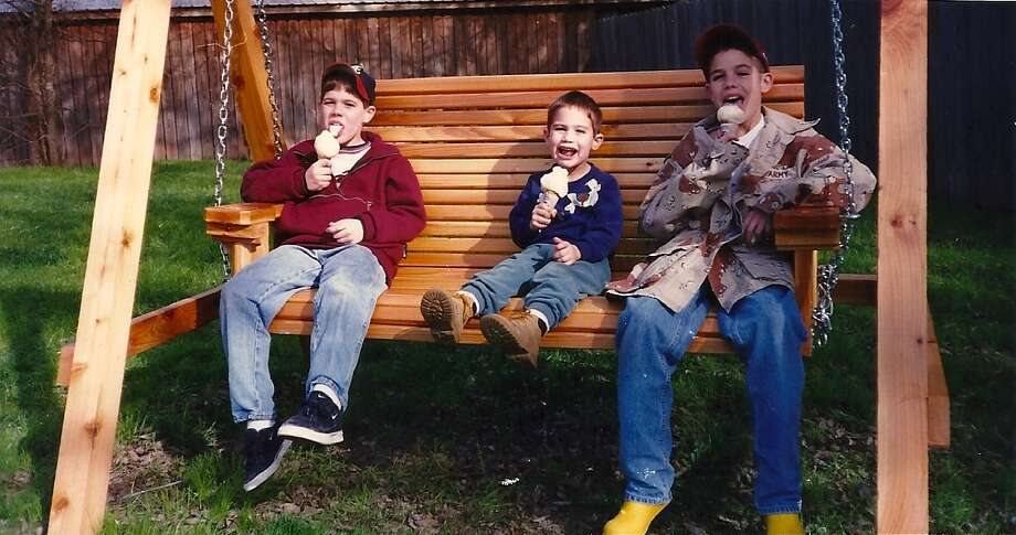 Then: In 1998, the Swain boys, Brandon 9, Dillon 4, and Colby 12 sit on a swing and enjoy some good-old Blue Bell ice cream. Photo: Swain, Reader Submission