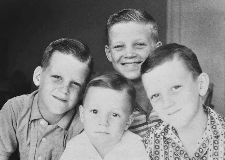 Then: Bothers John (clockwise from left), Frank, Mark and Henry Wright pose for a photo taken on Mother s Day in 1962 when their late father Frank was stationed in Puerto Rico with the Coast Guard. Photo: Henry Wright, Reader Submission