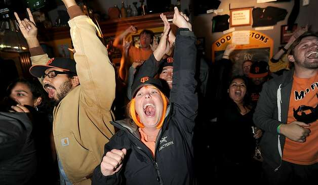 Lindsay Horstman celebrates with fellow Giants fans as their team clinches a spot in the World Series on Monday, Oct. 22, 2012, in San Francisco. Photo: Noah Berger, Special To The Chronicle