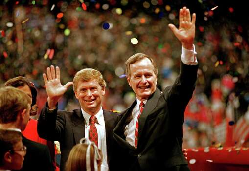 FILE - In this Aug. 18, 1988 file photo, Republican presidential candidate, Vice President George H.W. Bush,  right, and his running mate Sen. Dan Quayle, R-Ind., wave to the assembly of the Republican National Convention in New Orleans after their acceptance speeches for the presidential and vice-presidential nomination.  Long gone are the passionate debates. Long gone is the suspense about who will emerge as the party's presidential nominee. Political conventions now are carefully scripted pep rallies aimed at a national TV audience. Not since the 1970s, in fact, has the nation had a major-party national convention begin with the nominee in doubt. Americans already know how the story will end at this year's Republican and Democratic national gatherings. So have modern-day conventions become irrelevant?  (AP Photo/J. Scott Applewhite, File) Photo: J. Scott Applewhite, Associated Press / AP