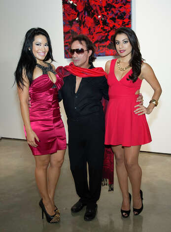 From the left, Angela Gomez, Karlos Anzoategui and Victoria Rodriguez at The Red Party, Fashion Week Kickoff at Texas A&M University San Antonio Educational & Cultural Arts Center, Monday, October 22, 2012 Photo: J. MICHAEL SHORT, FOR THE EXPRESS-NEWS / THE SAN ANTONIO EXPRESS-NEWS