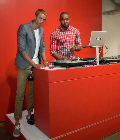 From the left, DJs Phillip Pines and Darryl Shular at The Red Party, Fashion Week Kickoff at Texas A&M University San Antonio Educational & Cultural Arts Center, Monday, October 22, 2012 Photo: J. MICHAEL SHORT, FOR THE EXPRESS-NEWS / THE SAN ANTONIO EXPRESS-NEWS