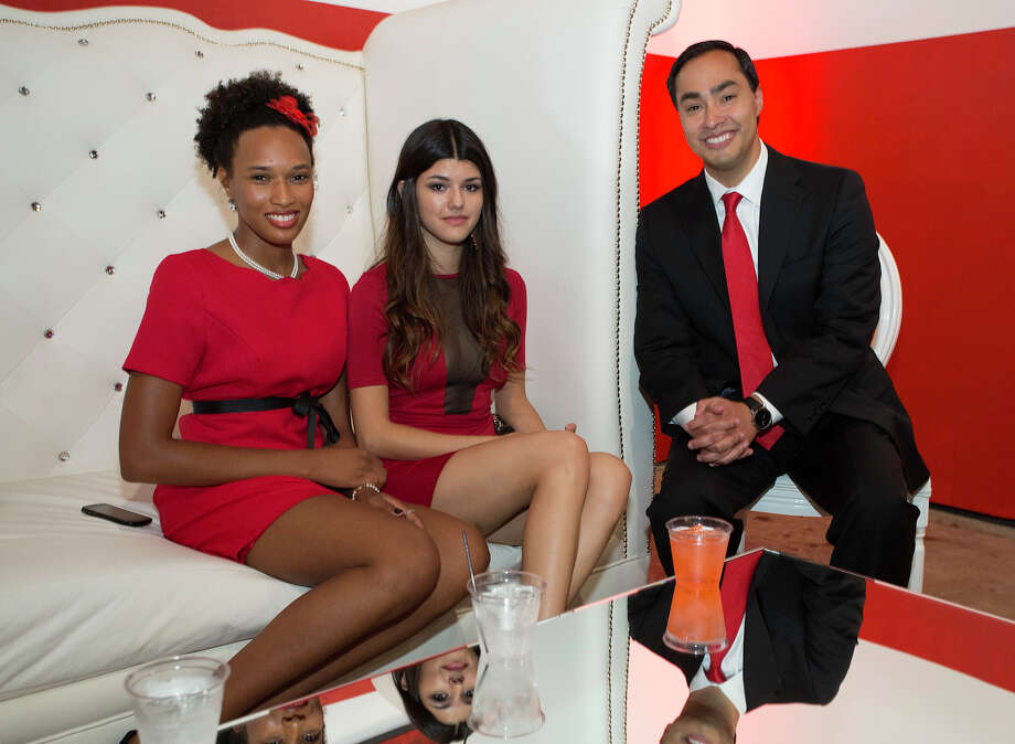 From the left, Zyaire Jones and Vanessa Ochoa with Joaquin Castro at The Red Party, Fashion Week Kickoff at Texas A&M University San Antonio Educational & Cultural Arts Center, Monday, October 22, 2012 Photo: J. MICHAEL SHORT, FOR THE EXPRESS-NEWS / THE SAN ANTONIO EXPRESS-NEWS
