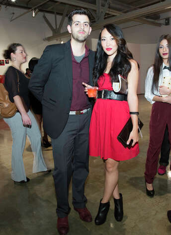 From the left, Chris Cantoya and Christina Coker at The Red Party, Fashion Week Kickoff at Texas A&M University San Antonio Educational & Cultural Arts Center, Monday, October 22, 2012 Photo: J. MICHAEL SHORT, FOR THE EXPRESS-NEWS / THE SAN ANTONIO EXPRESS-NEWS