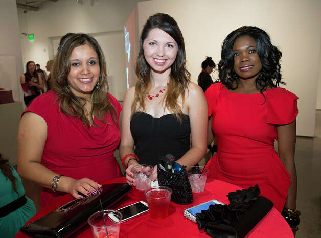From the left, Katrina Gallegos, Rachael Saunders and Glenda Jones at The Red Party, Fashion Week Kickoff at Texas A&M University San Antonio Educational & Cultural Arts Center, Monday, October 22, 2012 Photo: J. MICHAEL SHORT, FOR THE EXPRESS-NEWS / THE SAN ANTONIO EXPRESS-NEWS