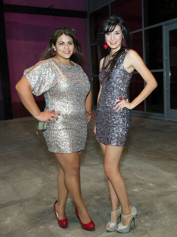 From the left, Nicole Herrera and Karen Ibarra at The Red Party, Fashion Week Kickoff at Texas A&M University San Antonio Educational & Cultural Arts Center, Monday, October 22, 2012 Photo: J. MICHAEL SHORT, FOR THE EXPRESS-NEWS / THE SAN ANTONIO EXPRESS-NEWS