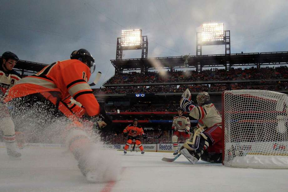 Last year's outdoor game saw the New York Rangers beat the host  Philadelphia Flyers at Citizens Bank Park. This year's game, if it even  happens, is expected to draw over 100,000 people at Michigan Stadium,   as the Red Wings host the Maple Leafs. Photo: Rob Carr, Getty Images / 2012 Getty Images