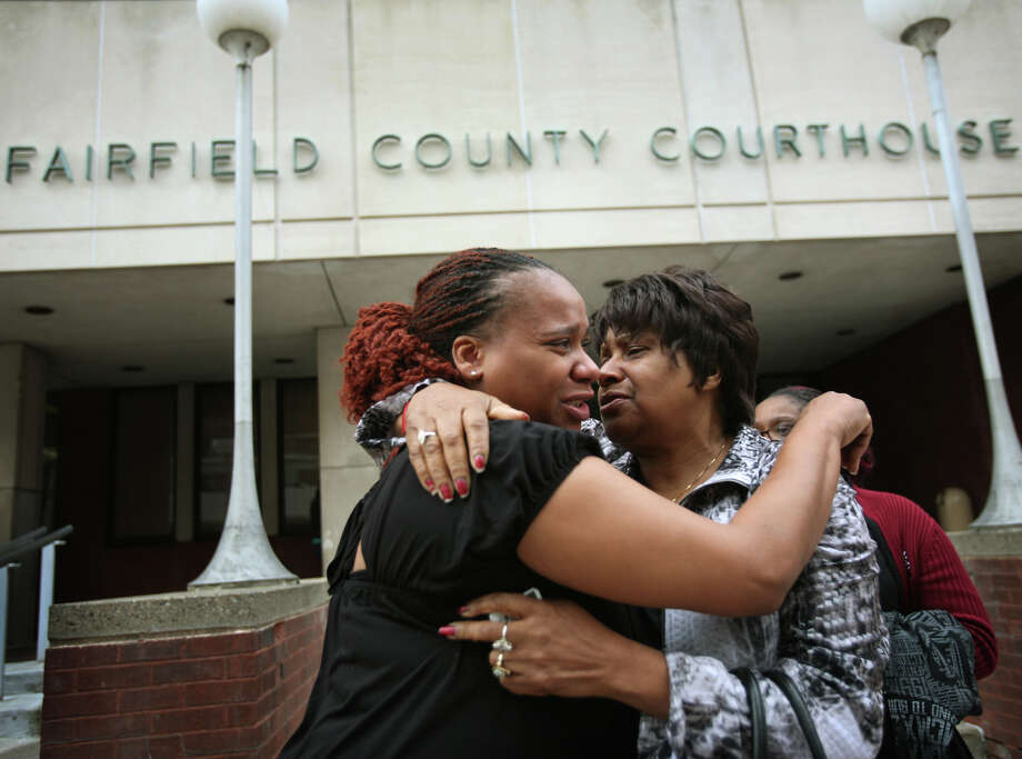Carlonetta McAllister, left, and Martha McAllister, of Florence, South Carolina, sister and mother of Frederick McAllister, console each other outside Superior Court on Main Street in Bridgeport on Tuesday, October 23, 2012. The city and Bridgeport police Lt. Brian Fitzgerald were cleared of civil wrongdoing in the shooting of McAllister on January 31, 2008. McAllister was shot in the back by Fitzgerald during a police chase. Photo: Brian A. Pounds / Connecticut Post