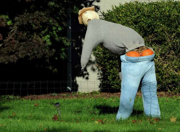 A comical scarecrow looks back at his drooping pants in a yard on Fairfield Woods Road in Fairfield, Conn. on Monday, Oct. 22, 2012. Photo: Cathy Zuraw / Connecticut Post
