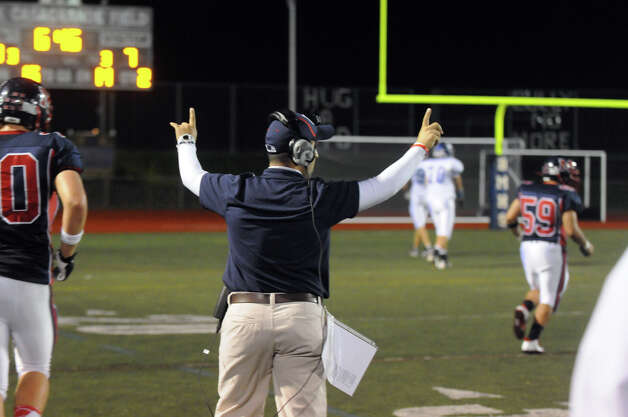 McMahon Coach AJ Albano reacts to a touchdown as Brien McMahon hosts Fairfield Ludlowe in a football game in Norwalk, Conn., Oct. 19, 2012. Photo: Keelin Daly / Stamford Advocate Freelance