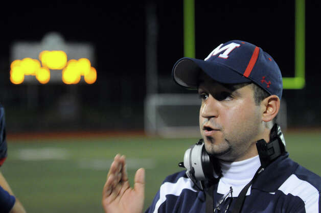 McMahon Coach AJ Albano talks to his team as Brien McMahon hosts Fairfield Ludlowe in a football game in Norwalk, Conn., Oct. 19, 2012. Photo: Keelin Daly / Stamford Advocate Freelance