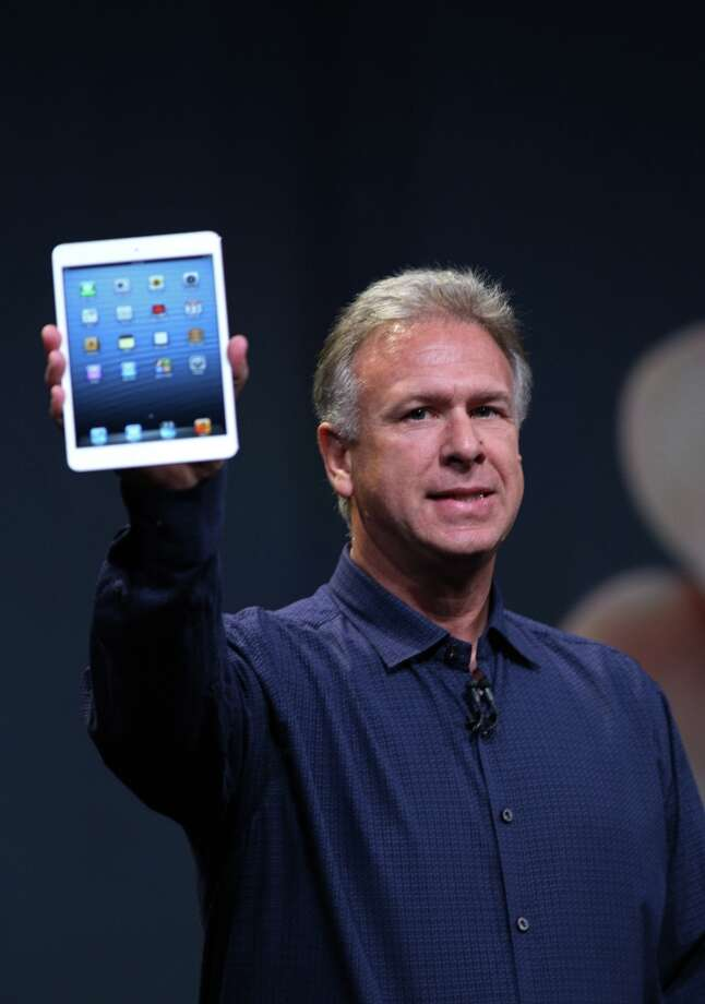 "Apple Senior Vice President of Worldwide Marketing Phil Schiller announces the iPad Mini during Apple's special event  at the California Theatre in San Jose on Tuesday. Anticipation built Tuesday as Apple unwrapped its ""iPad Mini,"" launching a foray into the crowded market of smaller tablet computers dominated by Amazon, Google, and Samsung. Photo: KIMIHIRO HOSHINO, AFP/Getty Images / AFP"