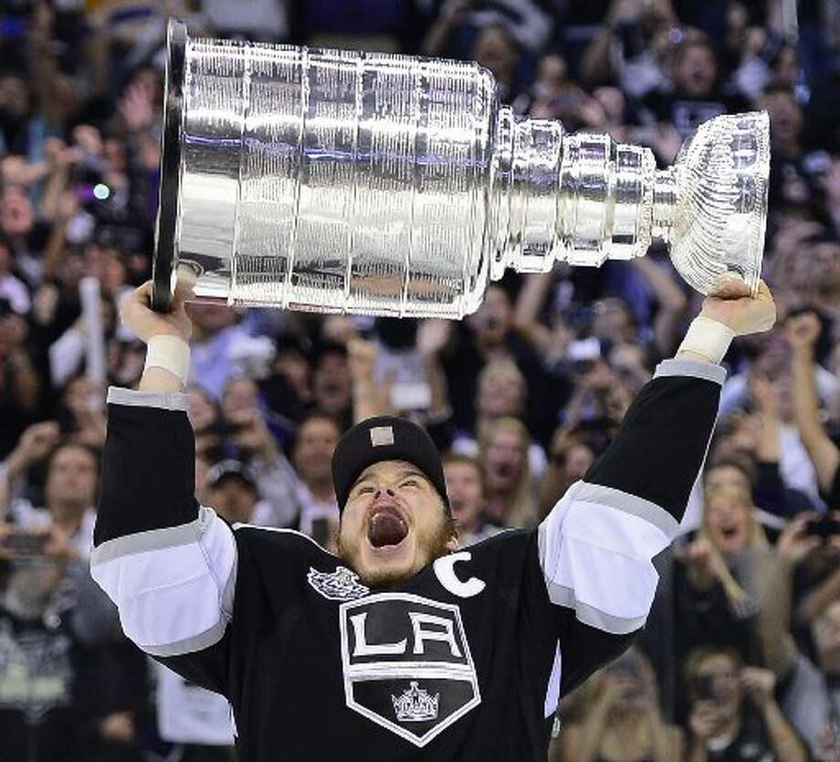 "Defending the Cup A big question always is: ""Will the defending Stanley Cup champions repeat?"" The Los Angeles Kings were kings of the NHL lasts season and the roster is pretty much the same as least year's Cup winning squad.  (Mark Terrill / AP)"