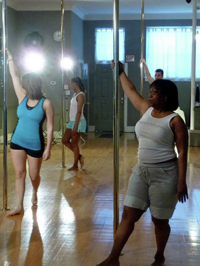 During the Dance for Pink celebration Sunday, visitors can try pole dancing, which combines cardio, pole movements and strength training. Photo: Contributed Photo