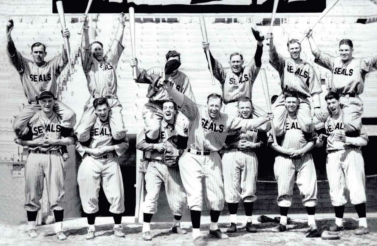 1935: Why are these players excited? The mighty Seals, with Lefty O'Doul (center) and Joe DiMaggio (lower right) had just won the Pacific Coast League title. (Chronicle file)