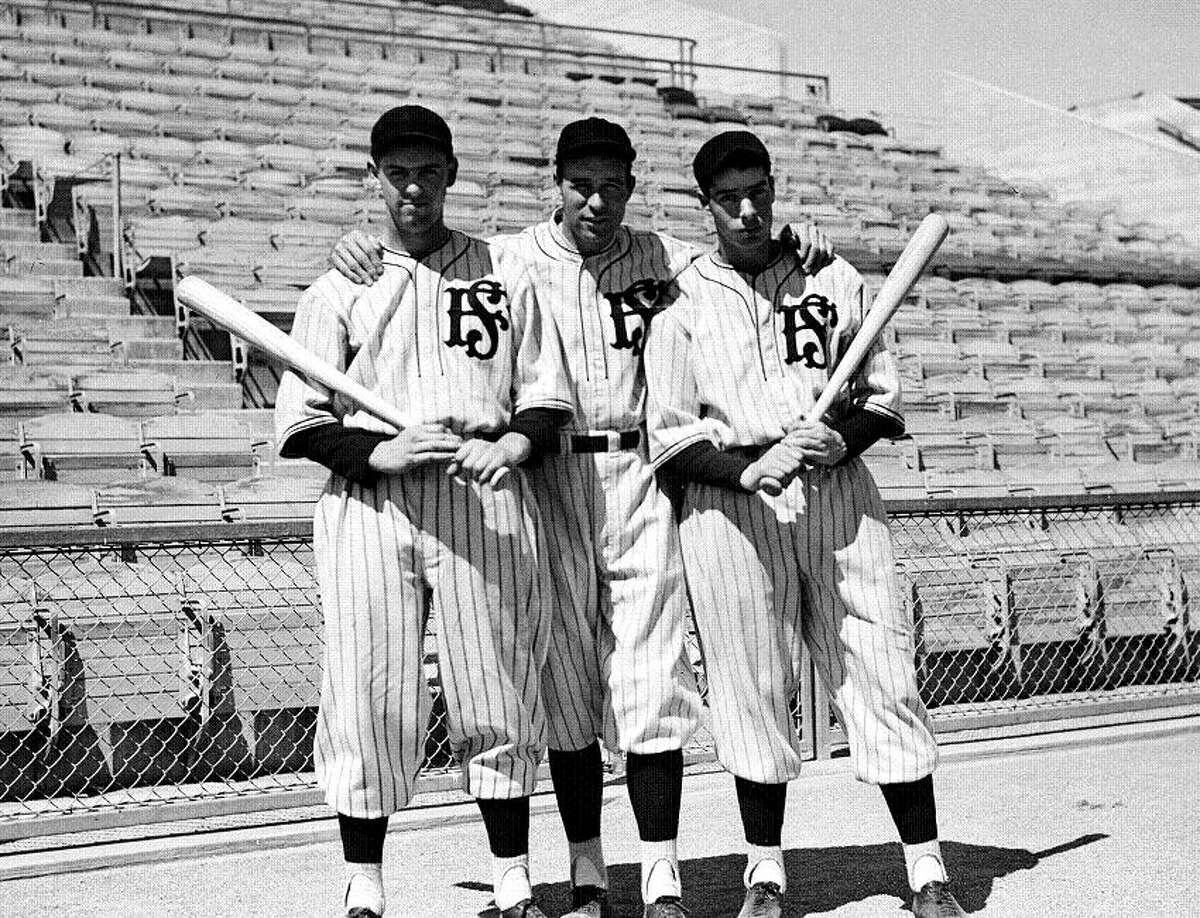 """July 11, 1935: Lefty O'Doul (center) with Joe Marty and Joe DiMaggio. How do you get a bridge and a bar named after you? Hit .349 in 15 years, manage your hometown team to three titles. It doesn't hurt to have an awesome name like """"Lefty O'Doul."""""""