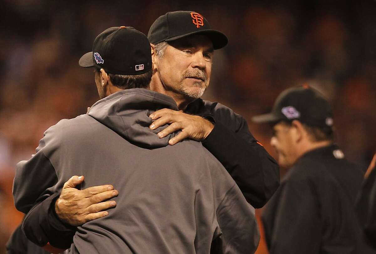 Giants' manager Bruce Bochy, congratulates starting pitcher, Ryan Vogelsong at the end of the game, as the San Francisco beat the St. Louis Cardinals 7-1 in game two, to tie the National League Championship Series at 1-1, at AT&T Park, the San Francisco, Calif., on Monday Oct. 15, 2012.