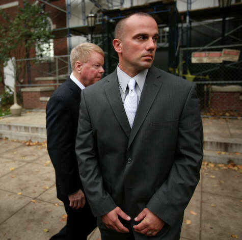 Former Milford police officer Jason Anderson and his lawyer Hugh Keefe exit Superior Court in Milford on Tuesday, October 23, 2012. Anderson is on trial for manslaughter for the June 13, 2009 deaths of Orange residents David Servin and Ashlie Krakowski. Photo: Brian A. Pounds / Connecticut Post