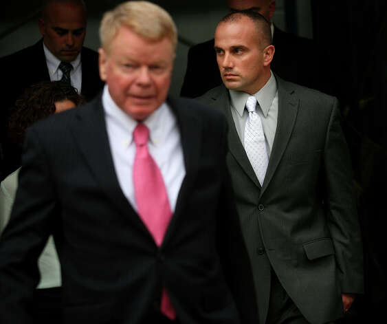 Former Milford police officer Jason Anderson, right, exits Superior Court in Milford on Tuesday, October 23, 2012. Anderson is on trial for manslaughter for the June 13, 2009 deaths of Orange residents David Servin and Ashlie Krakowski. Photo: Brian A. Pounds / Connecticut Post