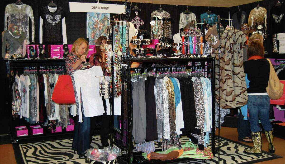 Shoppers check out the merchandise at the 2010 Holiday Olé Market sponsored by the Junior League of San Antonio.