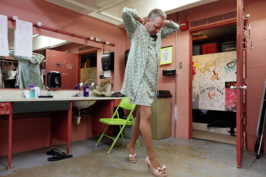 "Actor Andrew Thornton adjusts his costume during intermission of ""Greater Tuna."" Photo: Edward A. Ornelas, San Antonio Express-News / © 2012 San Antonio Express-News"