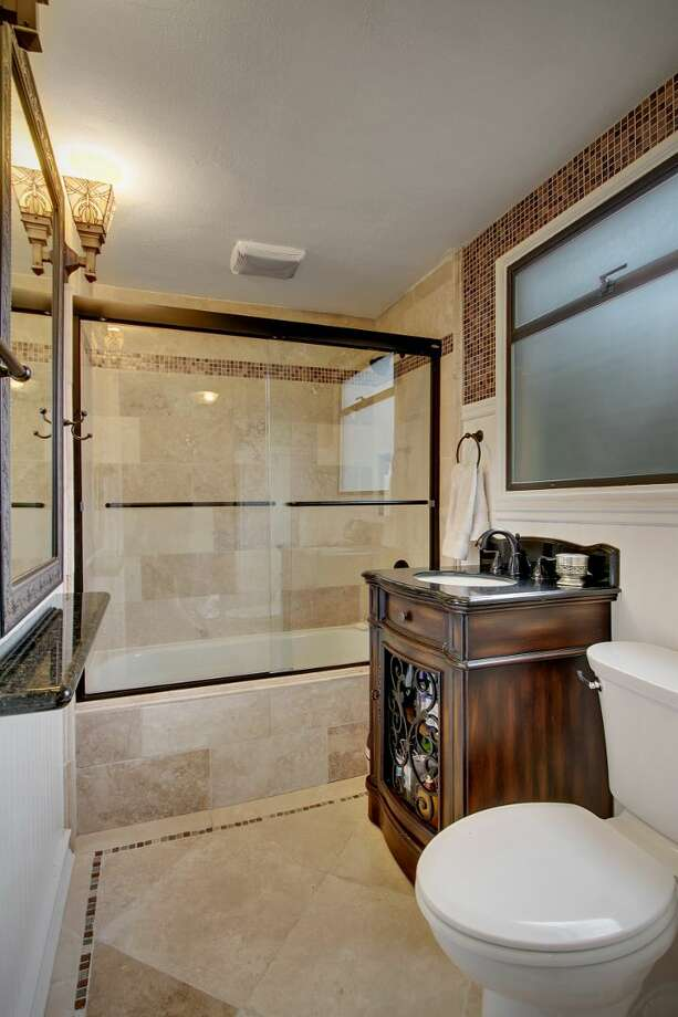 Bathroom of 8228 16th Ave. N.E. The 2,500-square-foot Tudor, built in 1928, has three bedrooms, 1.5 bathrooms, a basement rec room, curved windows and doorways, coved ceilings, an updated kitchen, and front and back decks on a 4,275-square-foot lot. It's listed for $499,950. Photo: Courtesy Phillip Greely/Windermere Real Estate