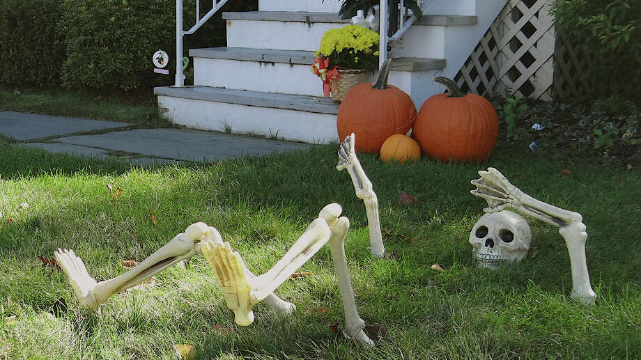 A skeleton begins to rise to the occasion for Halloween at this Oldfield Road home. Photo: Contributed Photo / Fairfield Citizen contributed