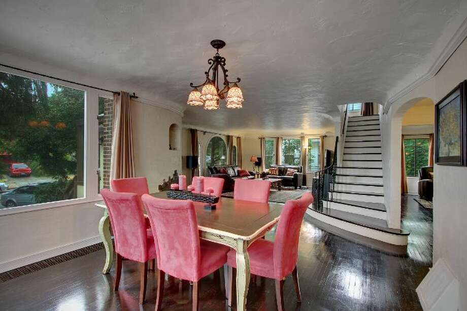 Dining room of 8228 16th Ave. N.E. The 2,500-square-foot Tudor, built in 1928, has three bedrooms, 1.5 bathrooms, a basement rec room, curved windows and doorways, coved ceilings, an updated kitchen, and front and back decks on a 4,275-square-foot lot. It's listed for $499,950. Photo: Courtesy Phillip Greely/Windermere Real Estate