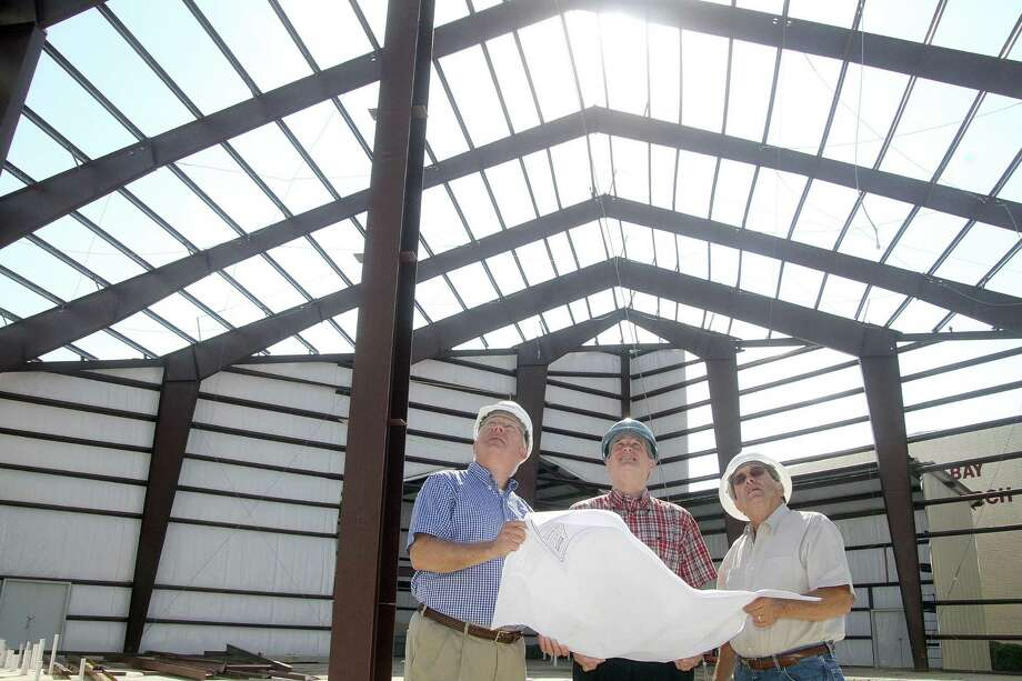 Checking construction of the sanctuary are, from left, John Kennedy, Building Committee chairman; David Fannin, senior pastor, Nassau Bay Baptist Church; and Steve Kennedy, project manager. Photo: Pin Lim / Copyright Pin Lim.