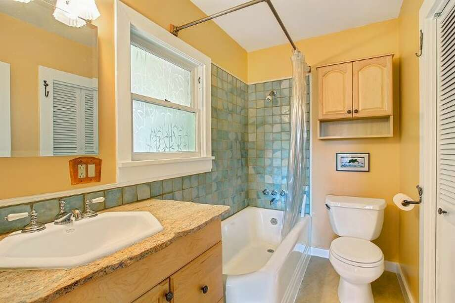 Bathroom of 1542 N.E. 88th St. The 1,917-square-foot house, built in 1936, has three bedrooms, two bathrooms, a guest house with a kitchen and three-quarter bathroom, a deck and a patio on a 7,250-square-foot lot. It's listed for $482,000, although a sale in pending. Photo: Courtesy Shawna Ader And Heather Berger/Windermere Real Estate