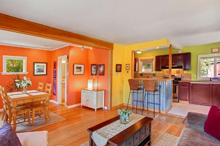 Living and dining rooms of 1542 N.E. 88th St. The 1,917-square-foot house, built in 1936, has three bedrooms, two bathrooms, a guest house with a kitchen and three-quarter bathroom, a deck and a patio on a 7,250-square-foot lot. It's listed for $482,000, although a sale in pending. Photo: Courtesy Shawna Ader And Heather Berger/Windermere Real Estate