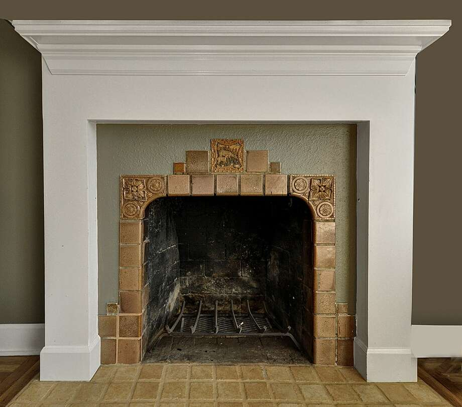 Fireplace of 8222 4th Ave. N.E. 2,120-square-foot house, built in 1929, has three bedrooms, 2.25 bathrooms, an updated kitchen, crown molding, a downstairs rec room, a front porch and a back deck on a 3,720-square-foot lot. It's listed for $479,000. Photo: Courtesy Teri Jones/Windermere Real Estate