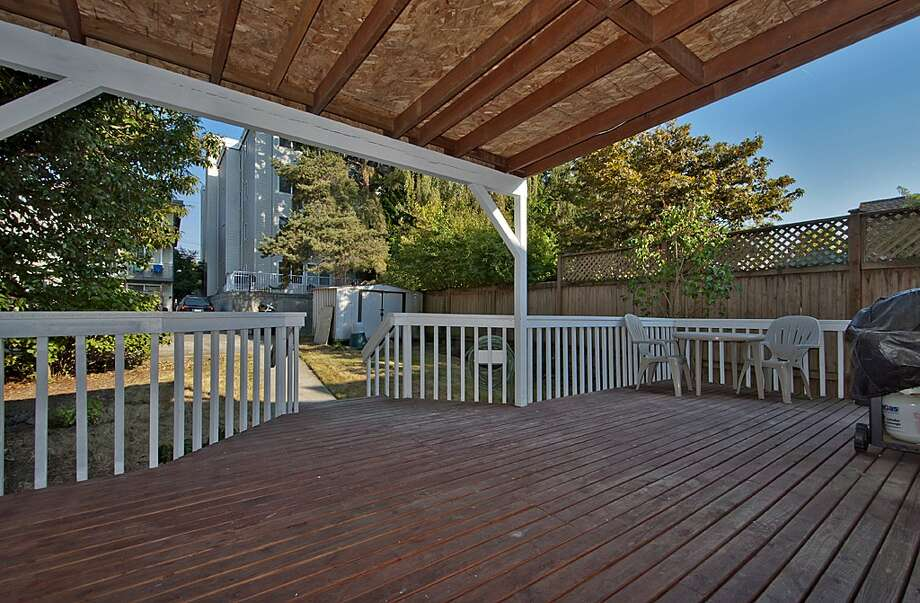 Back deck of 8222 4th Ave. N.E. 2,120-square-foot house, built in 1929, has three bedrooms, 2.25 bathrooms, an updated kitchen, crown molding, a downstairs rec room and a front porch on a 3,720-square-foot lot. It's listed for $479,000. Photo: Courtesy Teri Jones/Windermere Real Estate