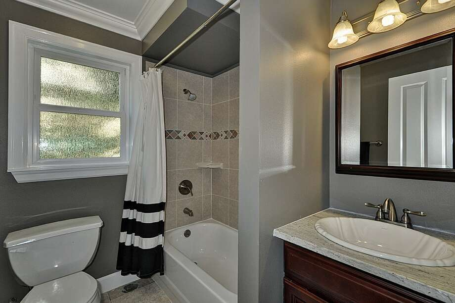 Bathroom of 8222 4th Ave. N.E. 2,120-square-foot house, built in 1929, has three bedrooms, 2.25 bathrooms, an updated kitchen, crown molding, a downstairs rec room, a front porch and a back deck on a 3,720-square-foot lot. It's listed for $479,000. Photo: Courtesy Teri Jones/Windermere Real Estate