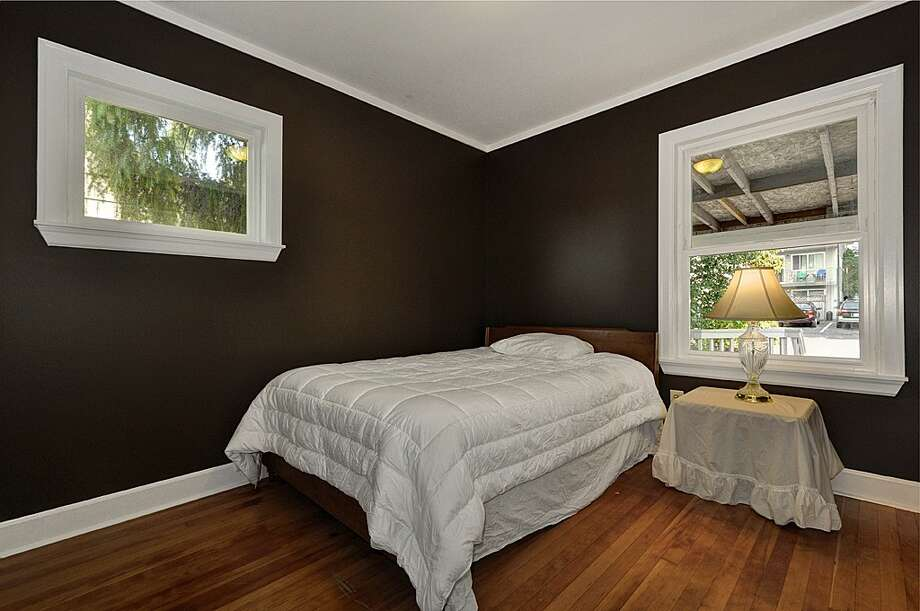 Bedroom of 8222 4th Ave. N.E. 2,120-square-foot house, built in 1929, has three bedrooms, 2.25 bathrooms, an updated kitchen, crown molding, a downstairs rec room, a front porch and a back deck on a 3,720-square-foot lot. It's listed for $479,000. Photo: Courtesy Teri Jones/Windermere Real Estate