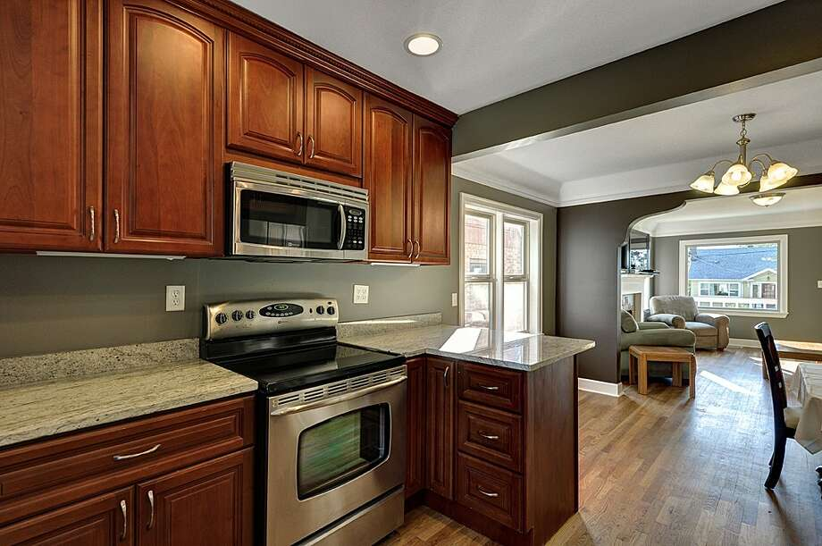 Kitchen of 8222 4th Ave. N.E. 2,120-square-foot house, built in 1929, has three bedrooms, 2.25 bathrooms, an updated kitchen, crown molding, a downstairs rec room, a front porch and a back deck on a 3,720-square-foot lot. It's listed for $479,000. Photo: Courtesy Teri Jones/Windermere Real Estate