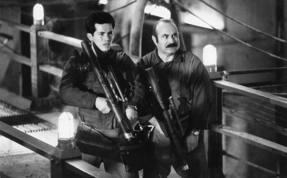 """John Leguizamo (left) and Bob Hoskins play Luigi and Mario in """"Super Mario Bros.,"""" a live-action film based on the game. Photo: Courtesy Allied Filmmakers"""
