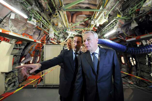 French Prime minister Jean-Marc Ayrault, right, and Airbus President and Chief Executive Officer Fabrice Bregier visit  an Airbus A350 XWB on the final assembly line in Toulouse, France, Tuesday Oct. 23, 2012. Photo: POOL, AFP/Getty Images / 2012 AFP