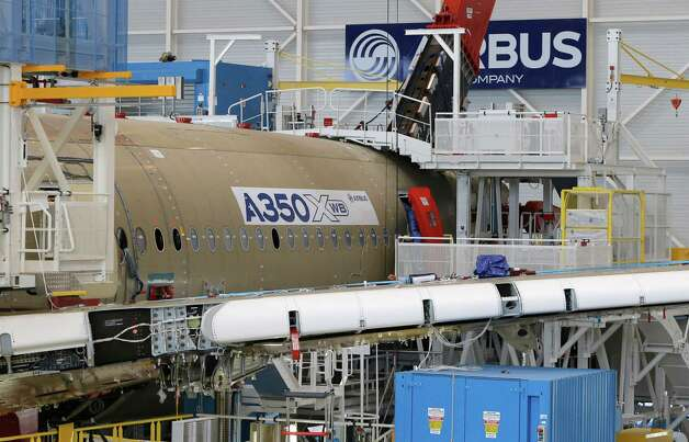 The main body section of the first Airbus A350 XWB is shown  on the final assembly line in Toulouse, France, Tuesday Oct. 23, 2012. Photo: AP