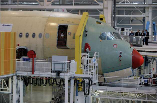 The nose section of the first Airbus A350 XWB is shown  on the final assembly line in Toulouse, France, Tuesday Oct. 23, 2012. Photo: AP