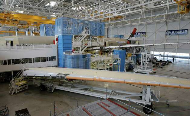 A wing of the first Airbus A350 XWB is shown  on the final assembly line in Toulouse, France, Tuesday Oct. 23, 2012. Photo: AP