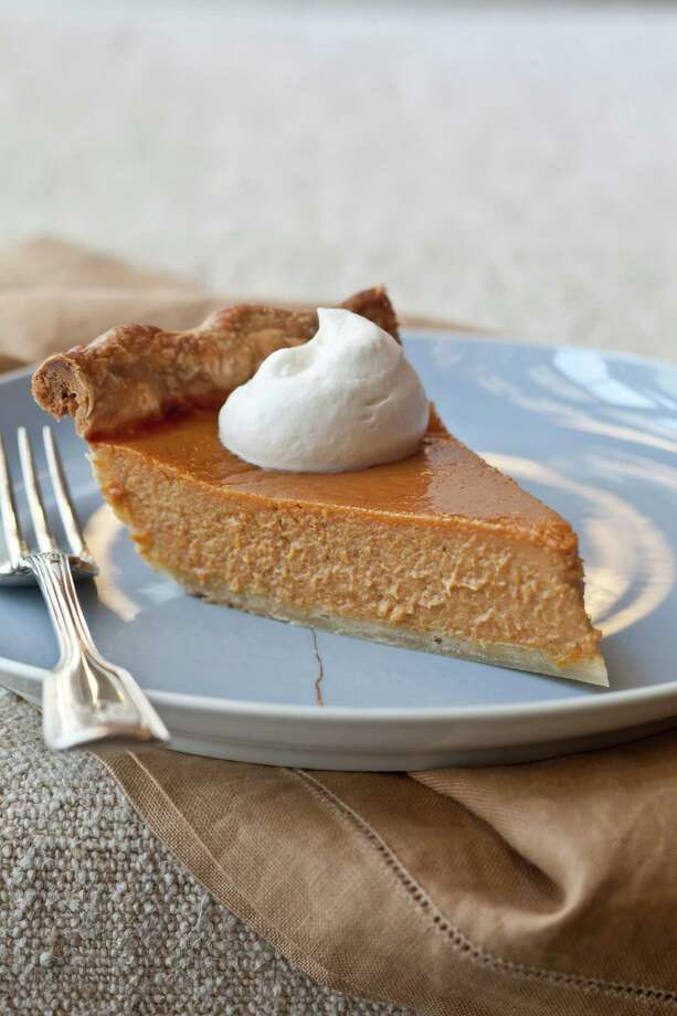 Ultimate Pumpkin Pie with Rum Whipped Cream  just might be the perfect dessert. Photo: Quentin Bacon / © Quentin Bacon
