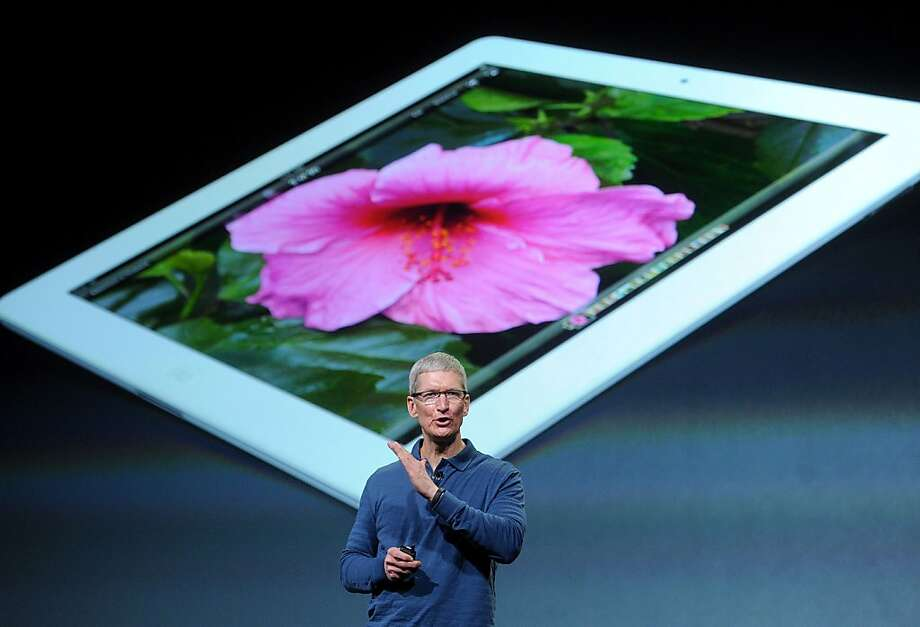 Apple CEO Tim Cook discusses the Mini, saying that iPads account for 91 percent of tablet Web traffic. Photo: Noah Berger, Bloomberg