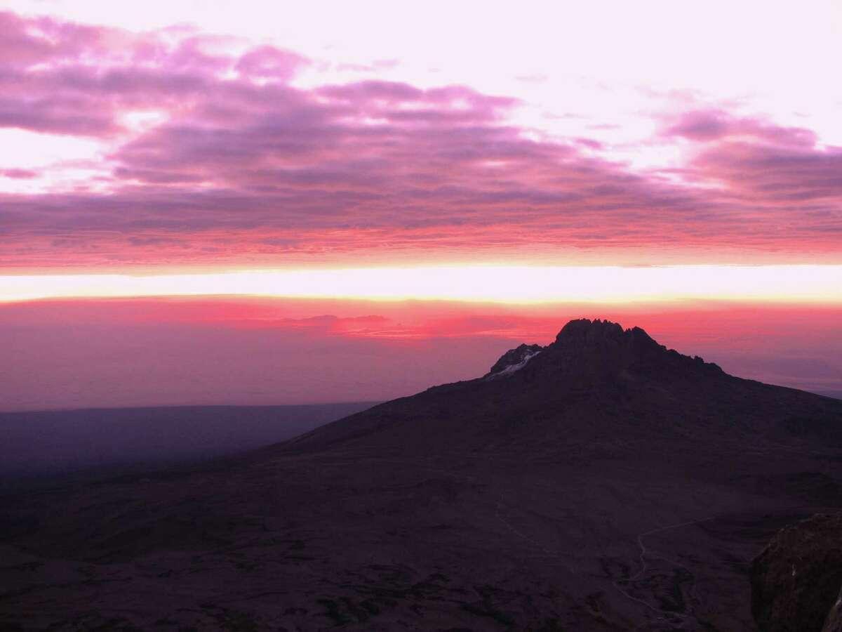 Venita Ray above the clouds on Mount Kilimanjaro