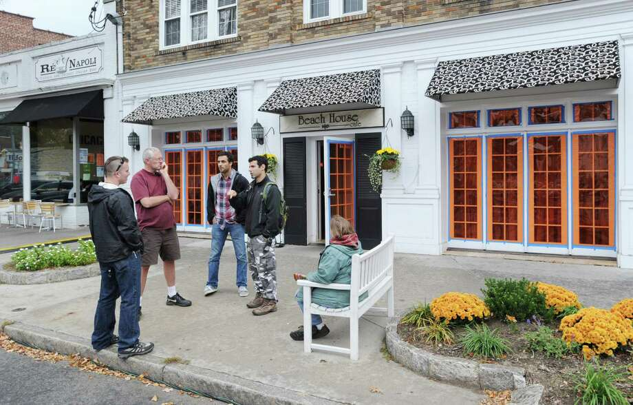 Crew members for Showtime's hit TV series, The Big C, take a break during shooting at the Beach House Cafe, 220 Sound Beach Ave., Old Greenwich. Tuesday afternoon, Oct. 23, 2012. Photo: Bob Luckey / Greenwich Time