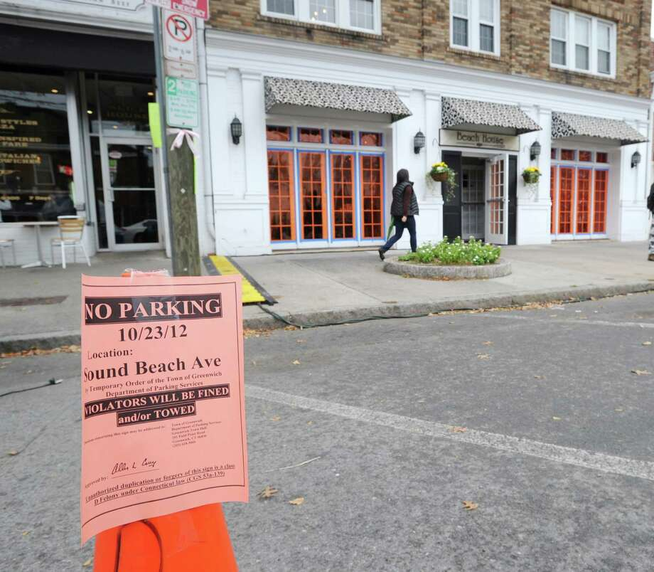"A ""No Parking"" sign in front of the Beach House Cafe at 220 Sound Beach Ave., Old Greenwich. Tuesday afternoon, Oct. 23, 2012. The Showtime hit TV series, The Big C, was shooting at the cafe. Photo: Bob Luckey / Greenwich Time"