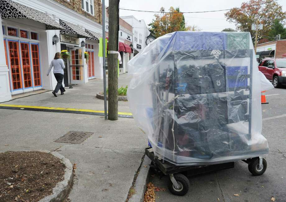 Television production equipment covered in plastic outside the Beach House Cafe at 220 Sound Beach Ave., Old Greenwich. Tuesday afternoon, Oct. 23, 2012. The Showtime hit TV series, The Big C, was shooting at the cafe. Photo: Bob Luckey / Greenwich Time