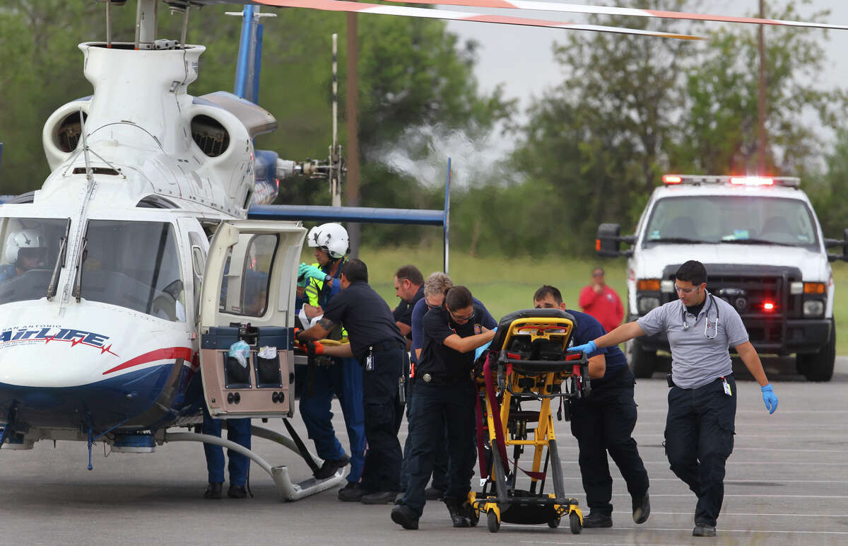 San Antonio EMS paremedics and Air Life personnel load a shooting victim into a helicopter in the parking lot of the Miller's Pond Community Center Tuesday October 23, 2012. A man in his late twenties was shot and found in a vacant lot at the corner of Port of Call and Old Sky Harbor around 10:00 a.m. San Antonio Police Chief Wiliam McManus said. The man was flown to University Hospital in unknown condition and the shooting suspect is still at large.